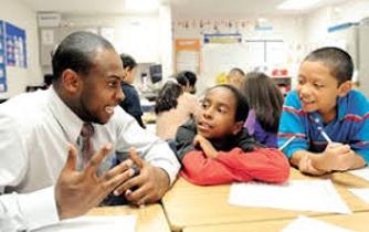 Male teacher with boys